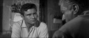Alan (Ronald Lewis) agrees to seek help from Dr. David Prade (Claude Dauphin) in Val Guest's The Full Treatment (1960)