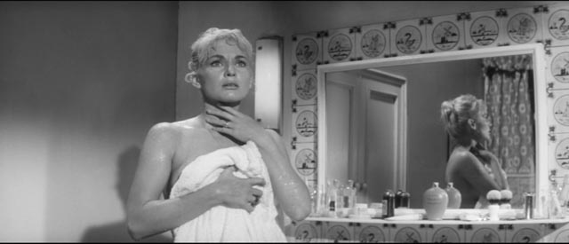 Denise Colby (Diane Cilento) becomes fearful of her husband's radical mood swings in Val Guest's The Full Treatment (1960)