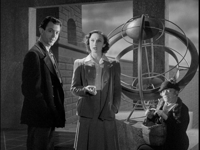 Joe Dinmore (John Clements), Alice (Googie Withers) and Mrs. Barley (Ada Reeve) see a possibility of radical change in Basil Dearden's They Came to a City (1944)