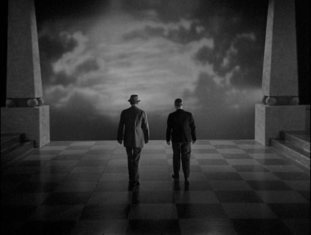 Sir George Gedney (A.E. Matthews) and Mr. Cudworth walk away from the Utopian dream in Basil Dearden's They Came to a City (1944)