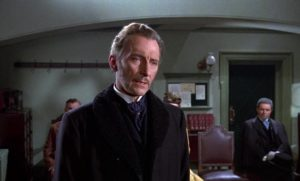 Dr. Namaroff (Peter Cushing) conceals what he knows about the strange deaths plaguing Villandorf in Terence Fisher's The Gorgon (1964)