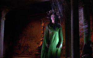 Megaera (Prudence Hyman) haunts the derelict Castle Borski in Terence Fisher's The Gorgon (1964)