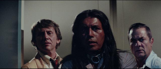 Dr. Hughes (John Cedar), Johns Singing Rock (Michael Ansara) and Harry Erskine (Tony Curtis) get their first look at Misquamacus in William Girdler's The Manitou (1978)