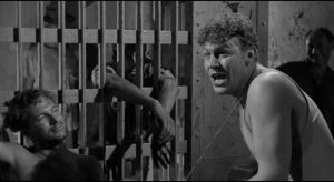 """Larry """"Lonesome"""" Rhodes (Andy Griffith performs in a smalltown Arkansas jail in Elia Kazan's A Face in the Crowd (1957)"""