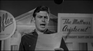 Lonesome (Andy Griffith) ridicules his sponsor's message in Elia Kazan't A Face in the Crowd (1957)