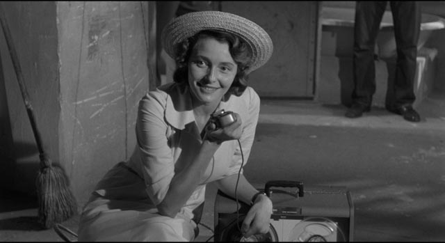 Marcia Jeffries (Patricia Neal) is immediately drawn to Lonesome(Andy Griffith)'s charismatic energy in Elia Kazan's A Face in the Crowd (1957)
