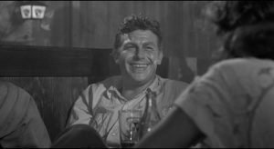 Out of jail, Lonesome (Andy Griffith) turns on the charm to consolidate his hold on Marcia (Patricia Neal) in Elia Kazan's A Face in the Crowd (1957)