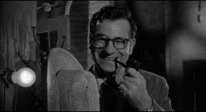 Mel Miller (Walter Matthau) initially views Lonesome (Andy Griffith)'s act with smug condescension, but eventually sees the danger in Elia Kazan's A Face in the Crowd (1957)