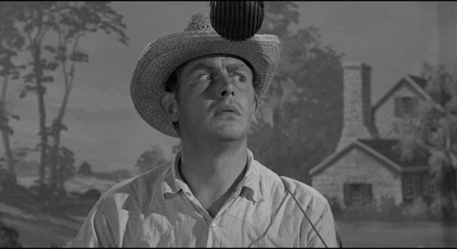 Making his TV debut, Lonesome (Andy Griffith) plays the country bumpkin to mock the medium in Elia Kazan's A Face in the Crowd (1957)