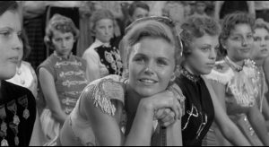 Cheerleader Betty Lou Fleckham (Lee Remick)'s adoration of the star makes her vulnerable to cruel exploitation in Elia Kazan's A Face in the Crowd (1957)