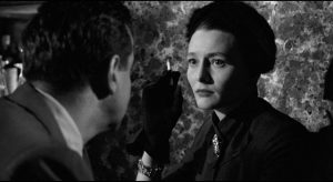 Used and abused, Marcia (Patricia Neal) is torn by her responsibility for Lonesome's rise to power in Elia Kazan's A Face in the Crowd (1957)