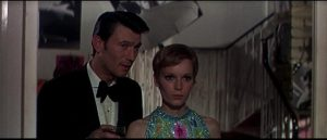Eberlin (Laurence Harvey) meets photographer Caroline (Mia Farrow) who offers an illusion of a normal life in Amthony Mann's A Dandy in Aspic (1968)