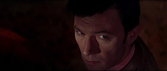 Eberlin (Laurence Harvey) knows he has no way out in Anthony Mann's A Dandy in Aspic (1968)