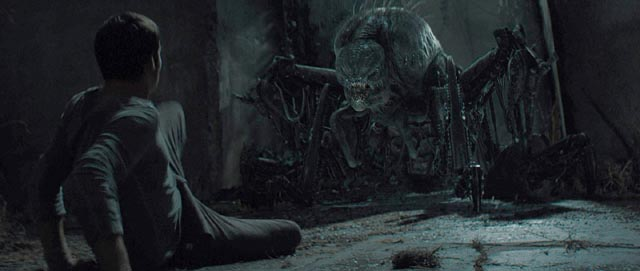Thomas (Dylan O'Brien) confronts a biomechanical Griever in Wes Ball's Maze Runner (2014)