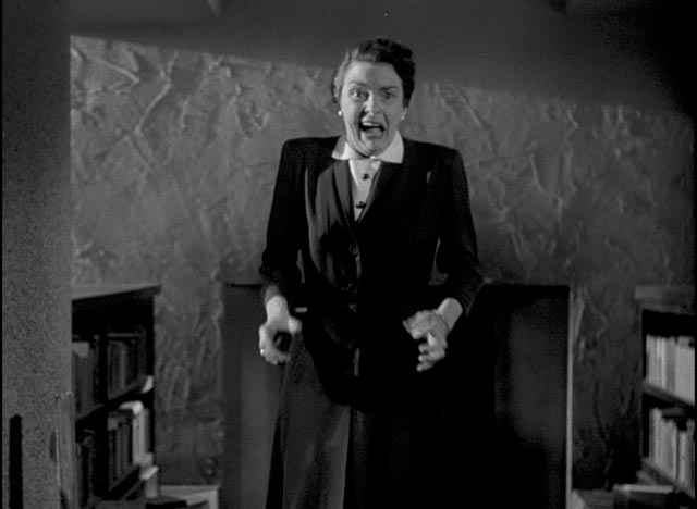 Aunt Edith (Katherine Emery) gets her first glimpse of the family secret in William Cameron Menzies' The Maze (1953)