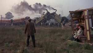 Joseph Finsbury (Ralph Richardson) surveys the liberating train wreck in Bryan Forbes' The Wrong Box (1966)