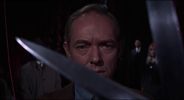 Michael Bryant contemplates the thread of his fate about to be severed in Freddie Francis' Torture Garden (1967)