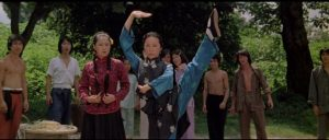 Fei-hung (Jackie Chan)'s Aunt (Linda Lin) teaches him a lesson in the market in Yuen Woo-ping's Drunken Master (1978)