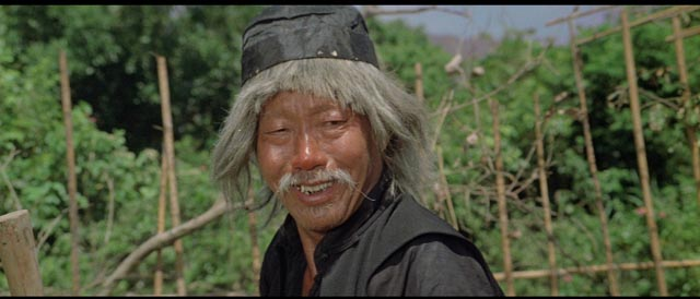 Beggar So (Yuen Siu-tien) hides his skill behind a clownish facade in Yuen Woo-ping's Drunken Master (1978)