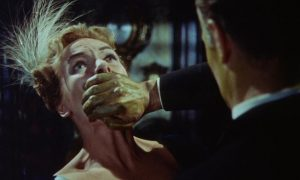 Dr. Bonnet (Anton Diffring) becomes toxic when he needs his elixir in Terence Fisher's The Man Who Could Cheat Death (1959)