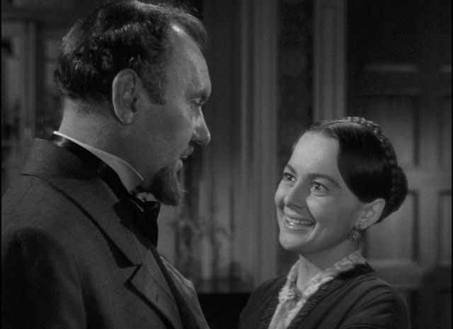 Catherine (Olivia de Havilland) tries to please her demanding father (Ralph Richardson) in William Wyler's The Heiress (1949)