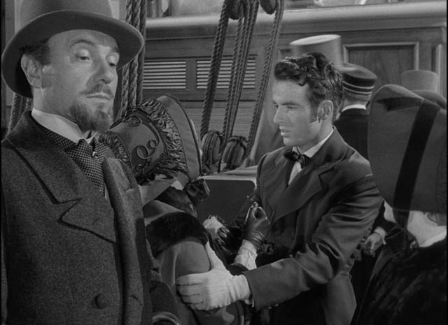 Dr. Sloper (Ralph Richardson) shows his disdain for Morris (Montgomery Clift) as he departs for Europe with Catherine (Olivia de Havilland) in William Wyler's The Heiress (1949)
