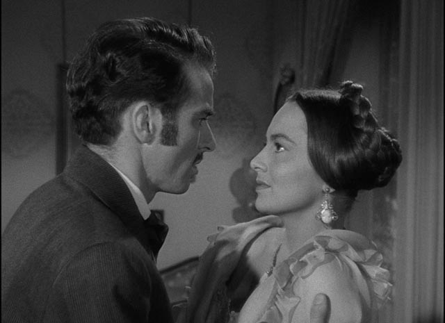 Morris (Montgomery Clift) imposes on Catherine (Olivia de Havilland)'s space as he courts her ... but she learns to resist his temptation in William Wyler's The Heiress (1949)