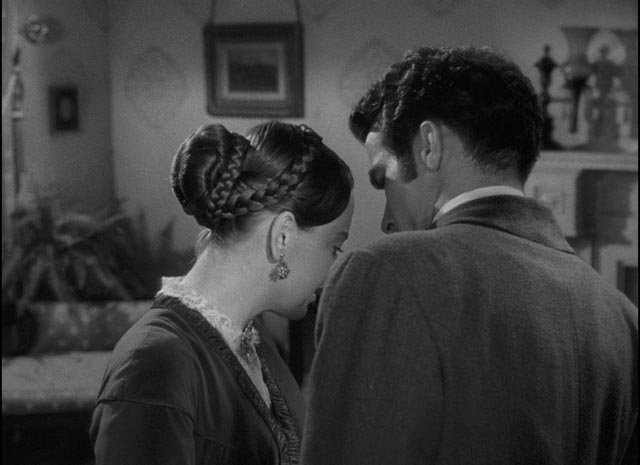 Morris (Montgomery Clift) presses, Catherine (Olivia de Havilland) resists in the awkward emotional ritual of courtship in William Wyler's The Heiress (1949)