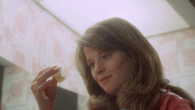 Barbara (Charlotte Rampling) is unable to give up her pills in Roy Ward Baker's Amicus anthology Asylum (1972)