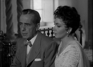 Humphrey Bogart as dissolute expatriate Billy Danreuther with wife Maria (Gina Lollobrigida) in John Huston's Beat the Devil (1953)