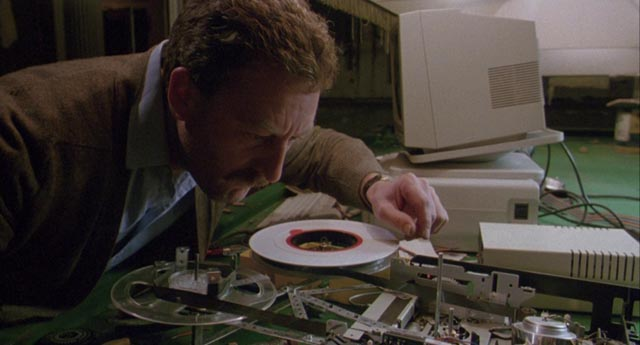 Bernard Hill deciphers a computer tape in Richard Loncraine's Bellman & True (1987)