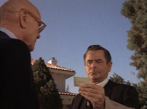 Prof. Andrew Patterson (Glenn Ford) receives instructions from his mentor Chad Harmon (Dean Jagger) in Paul Wendkos' The Brotherhood of the Bell (1970)