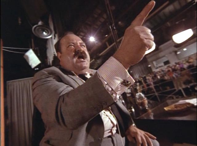 Paranoia reaches fever pitch when TV host Bart Harris (William Conrad) turns his audience against Patterson (Glenn Ford) in Paul Wendkos' The Brotherhood of the Bell (1970)