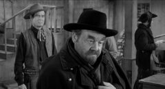 Rancher Blaise Starrett (Robert Ryan) is cautious with Jack Bruhn (Burl Ives) and his violent gang in Andre de Toth's Day of the Outlaw (1959)