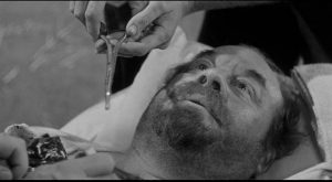 Bruhn (Burl Ives) has a bullet removed by the local doctor/vet in Andre de Toth's Day of the Outlaw (1959)