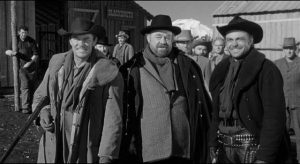 The gang prepare to teach Starrett (Robert Ryan) a lesson with a brutal beating in Andre de Toth's Day of the Outlaw (1959)