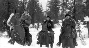 Starrett (Robert Ryan) leads Bruhn (Burl Ives)'s gang into a deadly wilderness in Andre de Toth's Day of the Outlaw (1959)