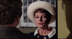 Mercy Croft (Coral Browne) delivers the bad news in person in Robert Aldrich's The Killing of Sister George (1968)