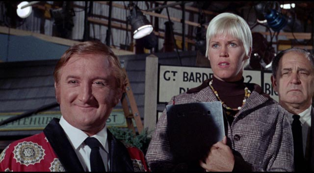 June (Beryl Reid)'s co-workers (Ronald Fraser and Rosalie Williams) enjoy witnessing her decline in Robert Aldrich's The Killing of Sister George (1968)