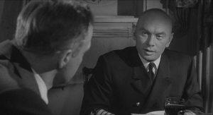 Captain Mueller (Yul Brynner) dislikes having an SS officer on his ship in Bernhard Wicki's Morituri (1965)