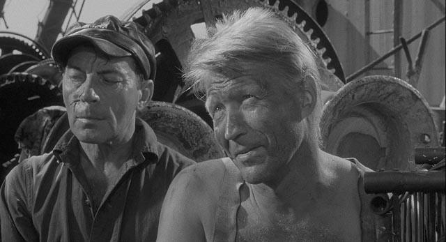 Political prisoner Donkeyman (Hans Christian Blech) distrusts Crain (Marlon Brando) in Bernhard Wicki's Morituri (1965)