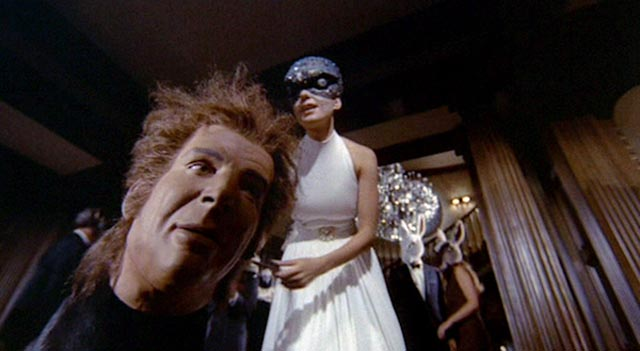 Reality and fantasy blend at a masked ball in Paul Wendkos' The Mephisto Waltz (1971)