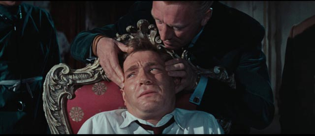 Neo-Nazi Oktober (Max von Sydow) tries to break Quiller (George Segal) with drugs in Michael Anderson's The Quiller Memorandum (1966)