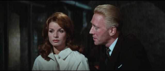 Oktober (Max von Sydow) uses Inge (Senta Berger) to manipulate Quiller (George Segal) in Michael Anderson's The Quiller Memorandum (1966)