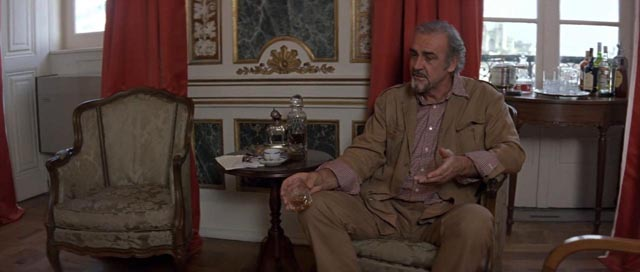 Barley (Sean Connery) is interrogated by British intelligence about his Russian connections in Fred Schepisi's The Russia House (1990)