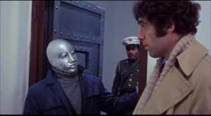 FBI agent Elliott Gould is suspicious of scientist Joseph Bova in Jack Gold's Who? (1974)