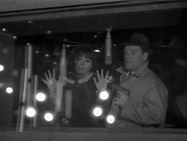 Natacha von Braun (Anna Karina) and Lemmy Caution (Eddie Constantine), by being human, cause the computer to self-destruct in Jean-Luc Godard's Alphaville (1965)