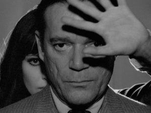 Lemmy Caution (Eddie Constantine) and Natacha von Braun (Anna Karina) confront a super-computer in Jean-Luc Godard's Alphaville (1965)