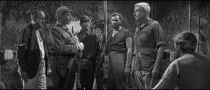 Colonel Lambert (Andre Morrell) tries to save the prisoners from a massacre in Val Guest's The Camp on Blood Island (1958)