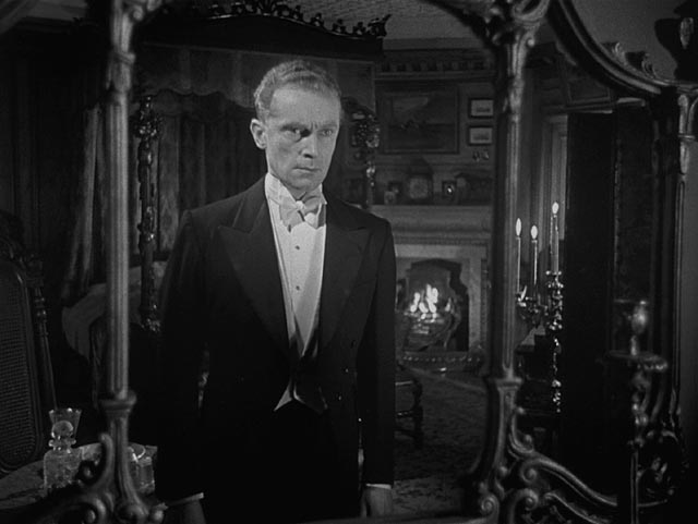 Peter Cortland (Ralph Michael) is possessed by a haunted mirror in Ealing's horror anthology Dead of Night (1945)